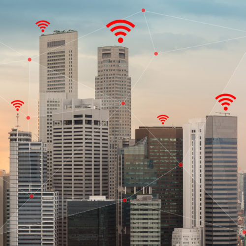 Concept of IOT and smart city illustrated by wireless networking and Wifi icon.