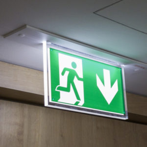 Emergency exit sign on a hospital ceiling - Run!